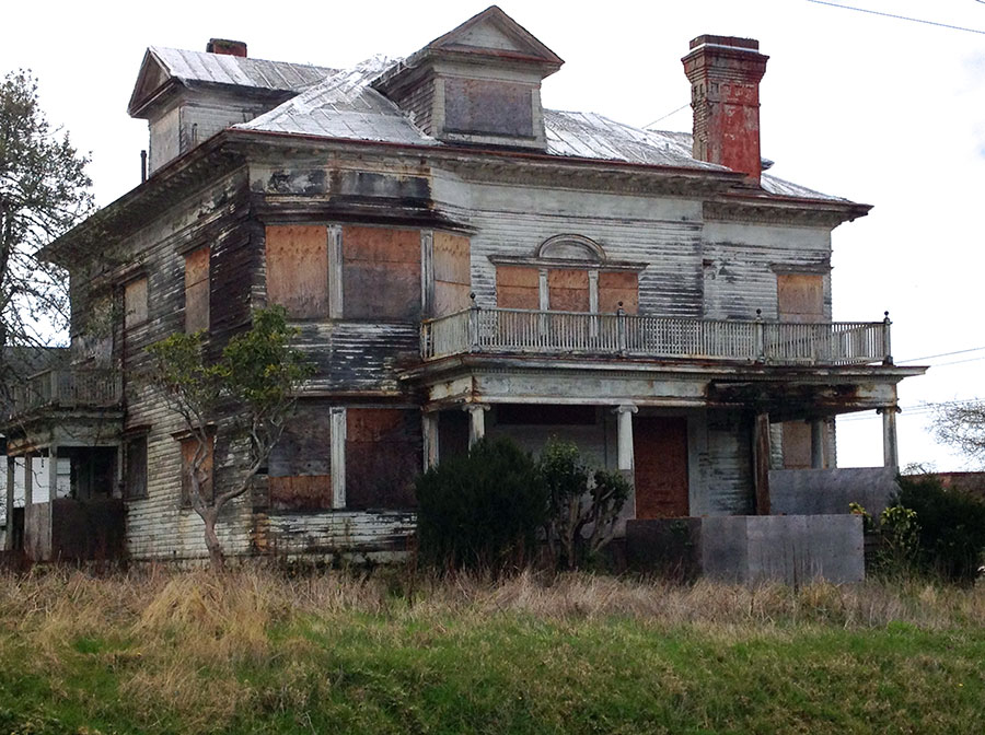 The legendary haunted Flavel House before restoration