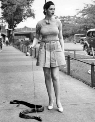 1940s burlesque queen Miss Zorita walking her snake