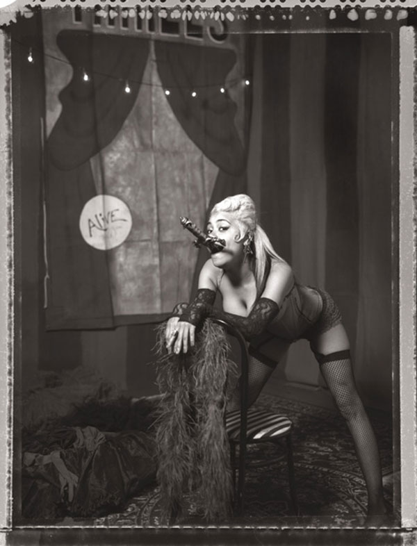 Sideshow performer Heather Holliday of the Pretty Things Peepshow swallowing a sword