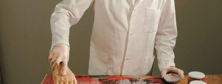 Artist Morten Viskum paints with severed hands