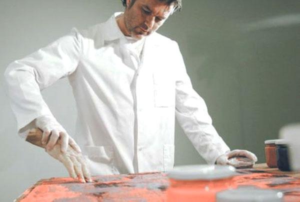 Artist Morten Viskum paints with dead hands