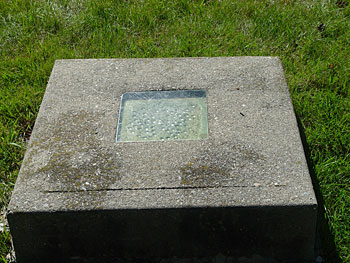 Grave with a window in New Haven, Vermont