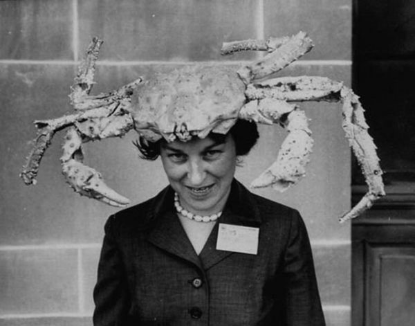 Vintage photo of a woman wearing a crab hat