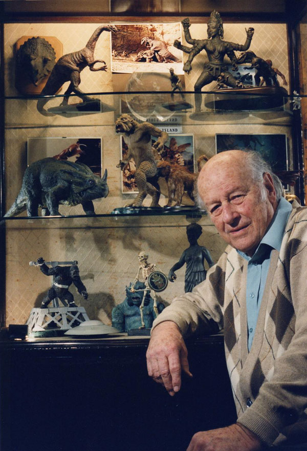 Ray Harryhausen posing with his creatures