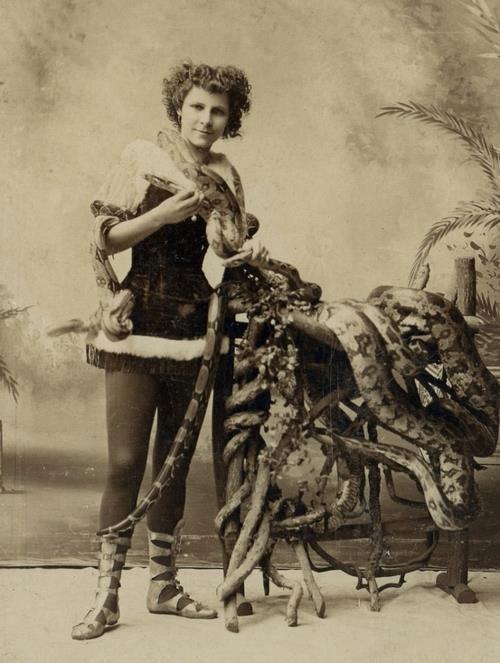 Vintage circus sideshow snake charmer photo