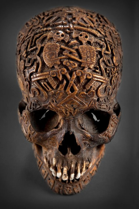Forhead of the skull engraved with Citipati skeleton figures