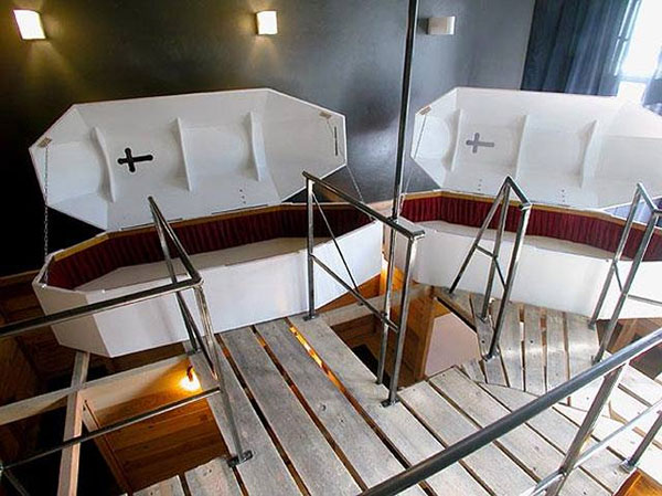 Sleep in a coffin hotel bed