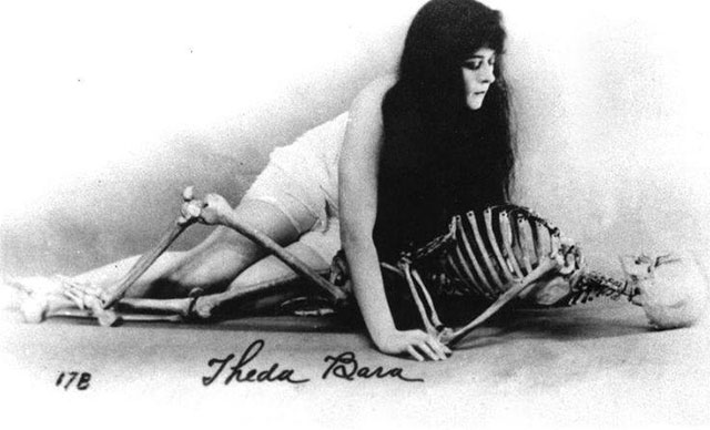 Silent film actress Theda Bara with a skeleton