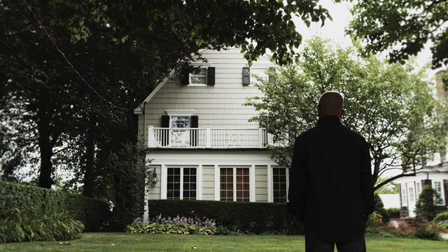 Daniel Lutz stands in front of the real-life Amityville horror house at 112 Ocean Ave in Amityville, NY