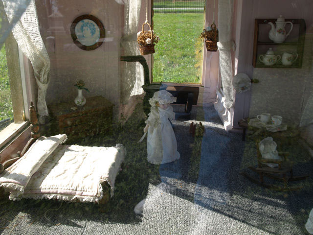 The interior of Vivian Mae Allison's dollhouse grave