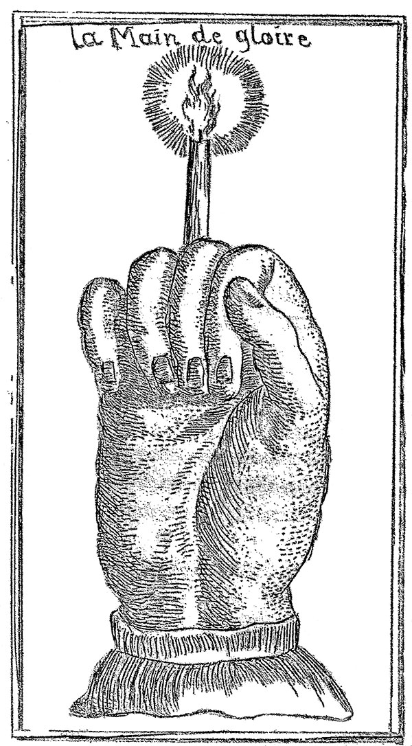 Illustration of a Hand of Glory holding a candle from the 18th century grimoire Le Petit Albert