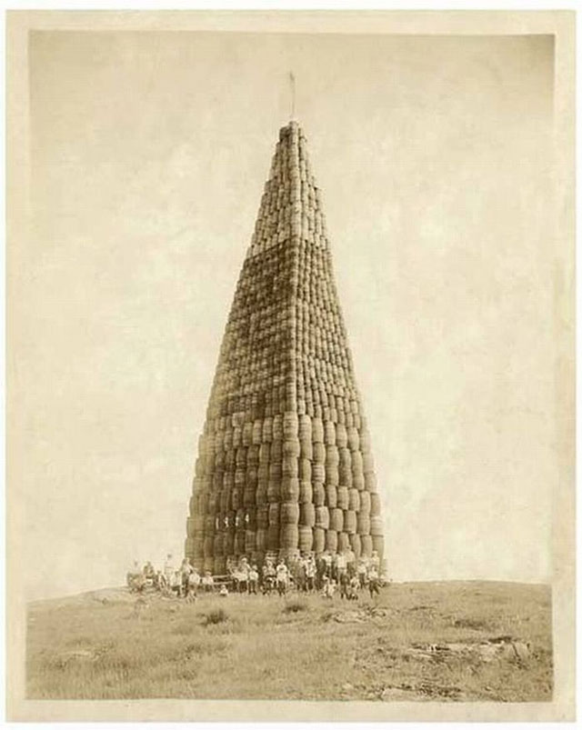 A tower of liquor barrels to be burned during the Prohibition