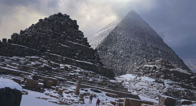 Snow covers the Giza pyramids after the first snow fall in Egypt in 112 years
