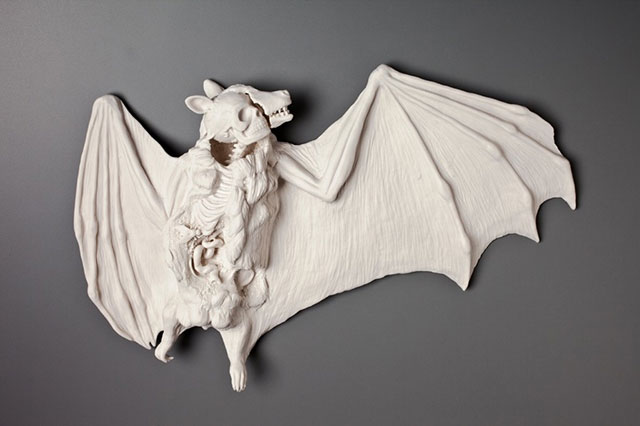 Dead bat with human bones porcelain sculpture by Kate Macdowell