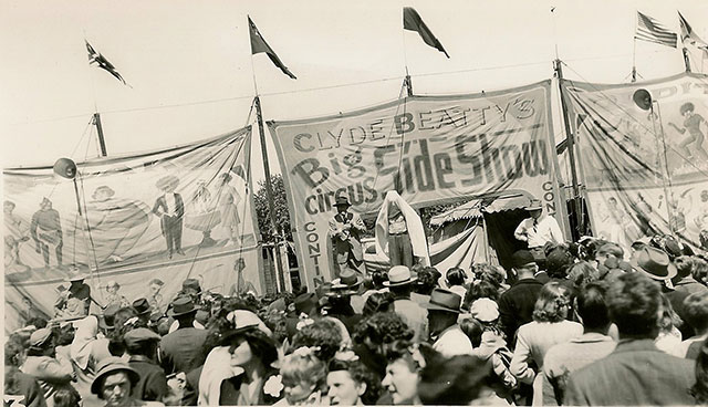 Vintage photos of a crowd gathered to see Clyde Beatty's circus freaks