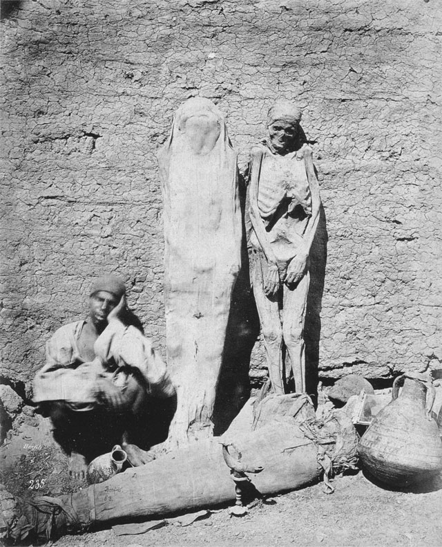 Vintage photo of a man selling mummies, dated 1875.