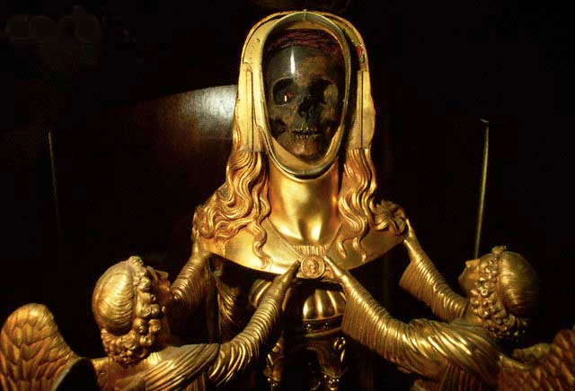 The skull of Mary Magdalene encased in a bizarre golden reliquary in the basilica of St. Maximin in France
