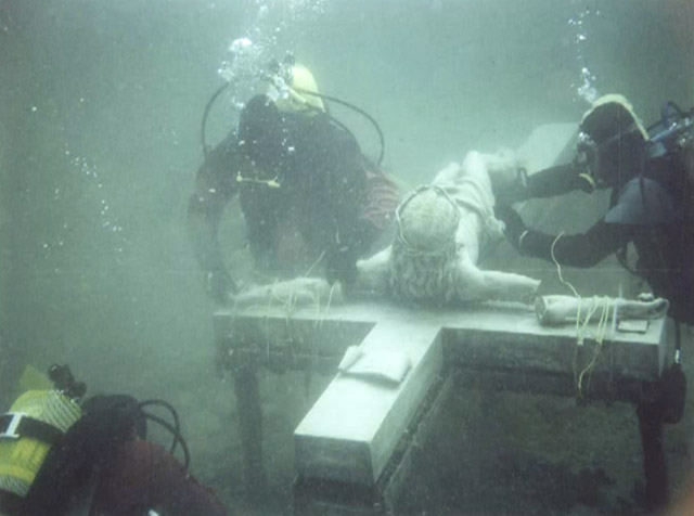 The underwater crucifix being raised for repairs in 1985