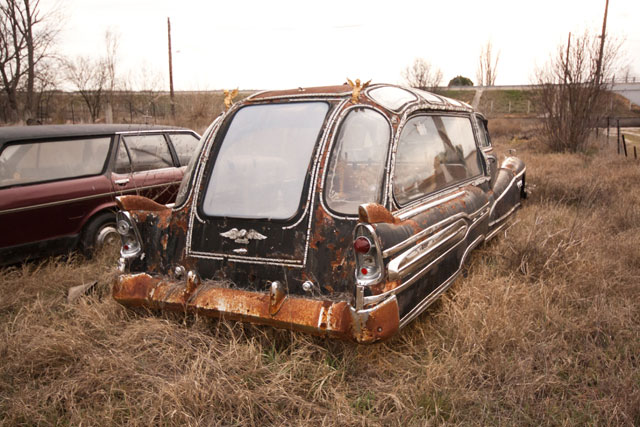 1947 Buick hearse rusting in a field in Greece