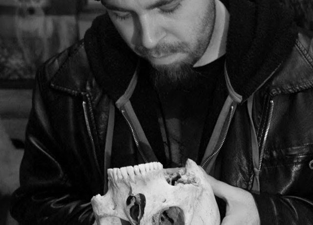 Cult of Weird creator Charlie Hintz with a human skull at the Mad Taxidermist's shop