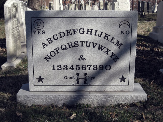 Ouija board gravestone of talking board creator Elijah Bond