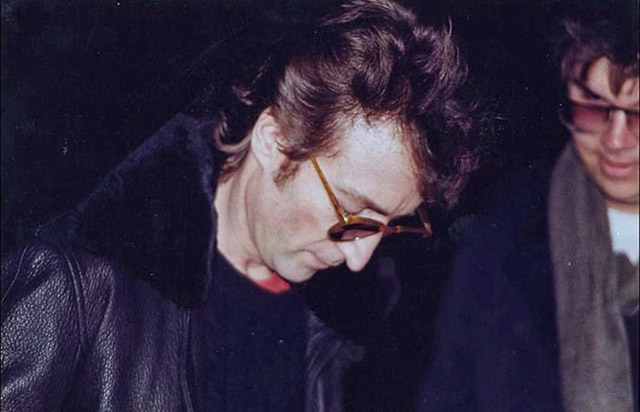 John Lennon signs an autograph for Mark David Chapman, the man who killed him