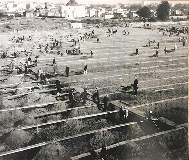 Workers exhuming graves in the Odd Fellows Cemetery