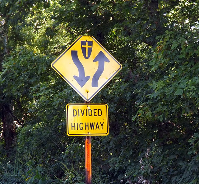 Indiana road divided by a grave
