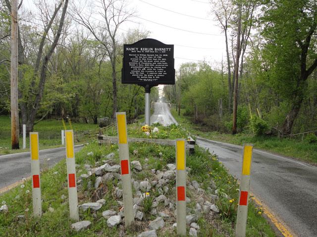 Nancy Barnett's grave in the middle of the road