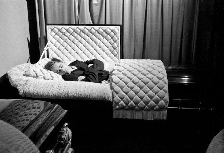 James Dean poses in a funeral parlor seven months before his death