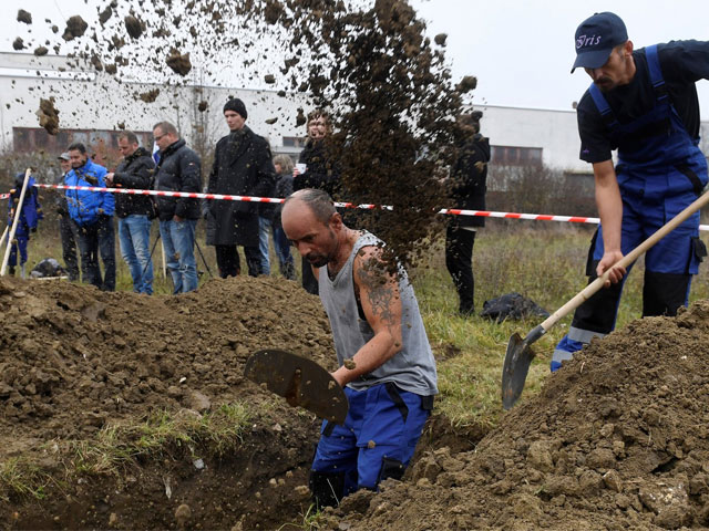 Grave diggers compete to see who can dig the fastest