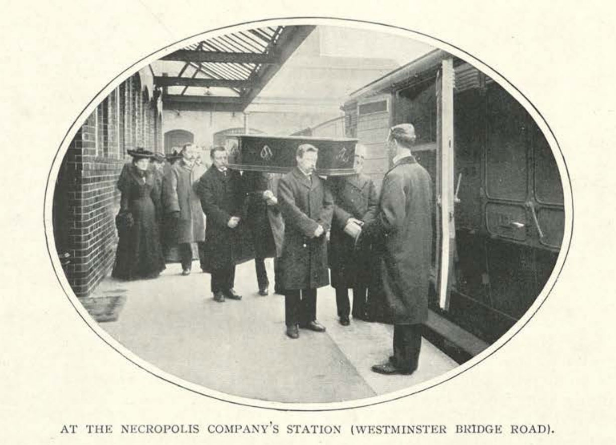 Mourners carry a coffin onto the train at the London Necropolis Railway station