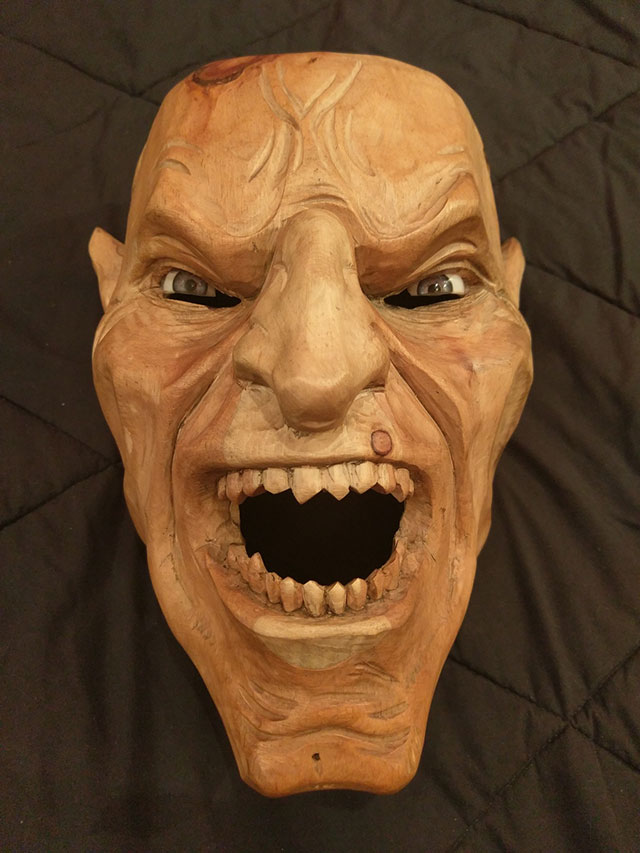 Hand-crafted wooden Krampus mask