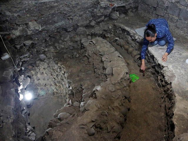 Archaeologists unearth hundreds of human skulls in Aztec tzompantli