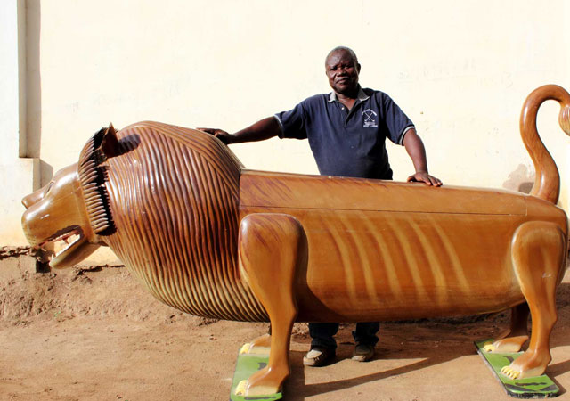 Paa Joe with his lion coffin
