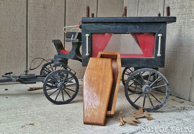 Handmade horse-drawn hearse model