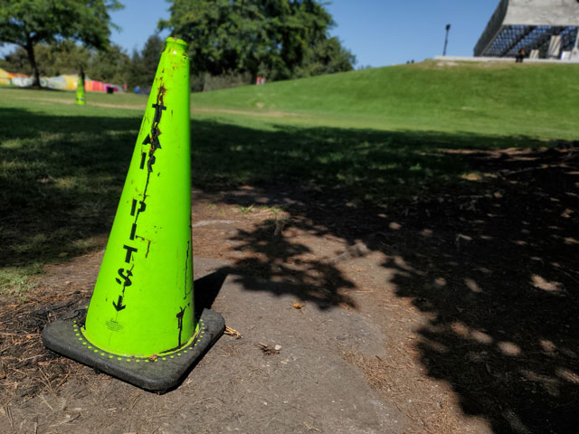 Road cones mark areas where asphalt has bubbled up