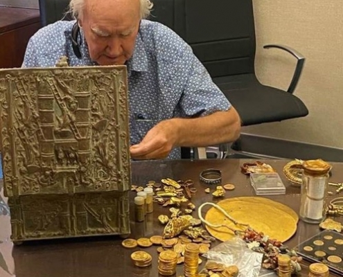 Forrest Fenn looks over the contents of his recently found treasure