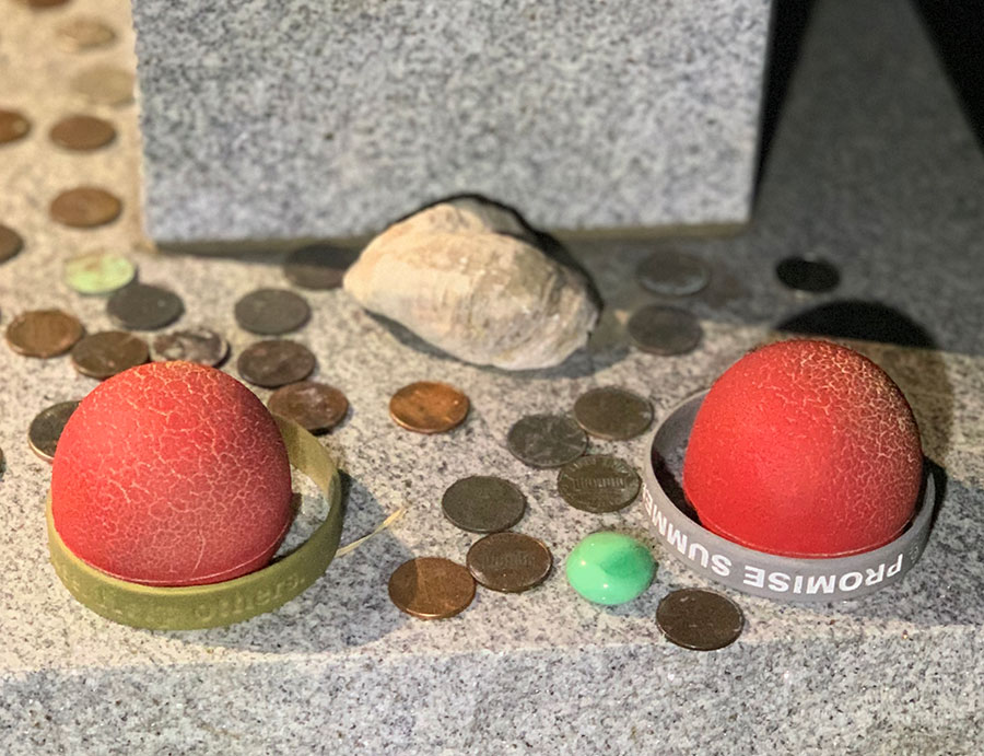 Clown noses left at a grave in the Showmen's Rest cemetery in Hugo, Oklahoma