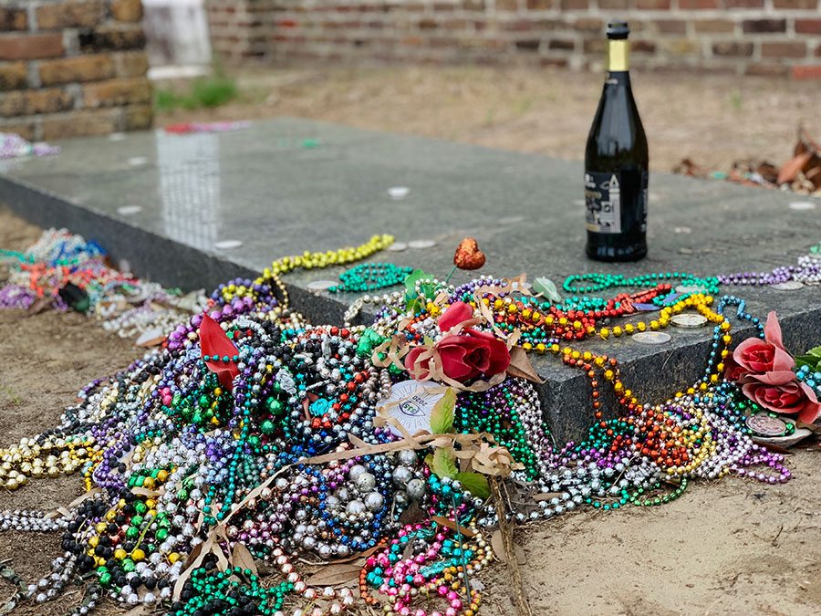 Grave covered in Mardi Gras beads