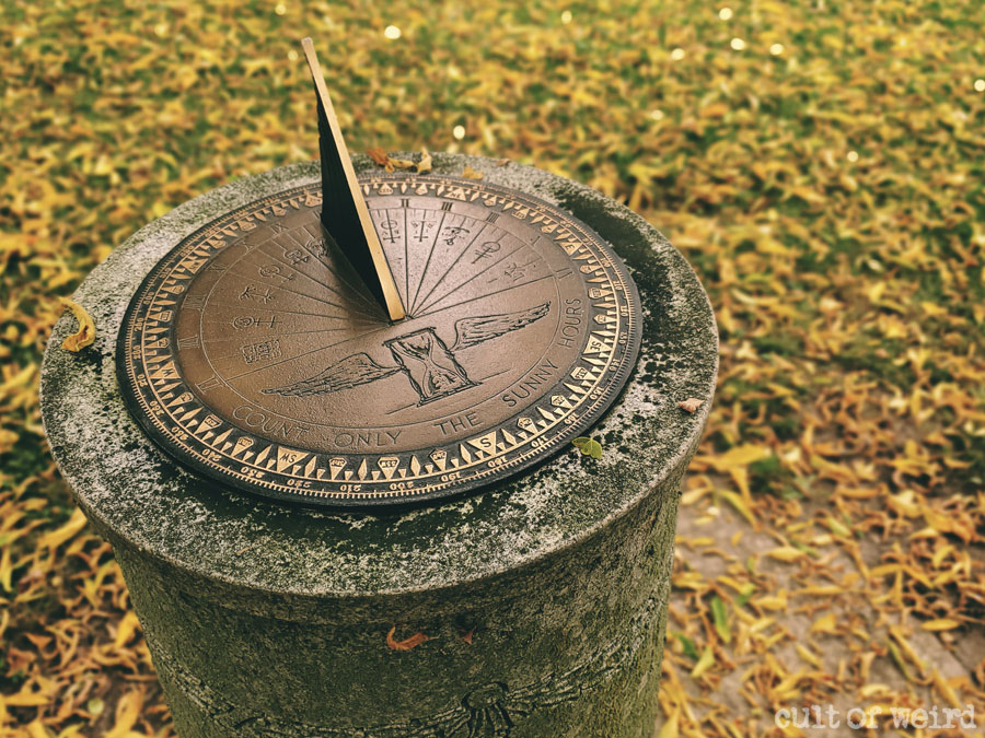 Bronze sundial grave marker engraved with medieval publisher's marks