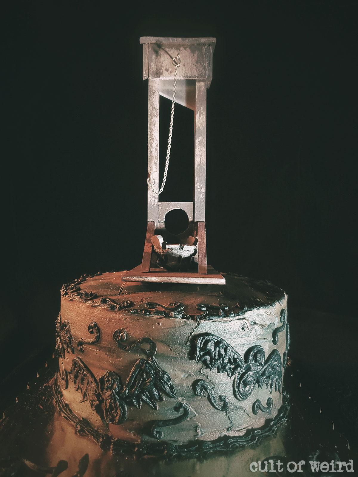 Addams Family guillotine cake