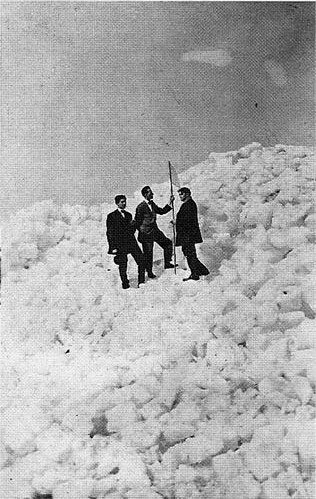 "People pose for ""North Pole expedition"" photos on a mountain of Wisconsin Lakes ice in Milwaukee c.1900"